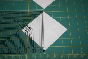 Marking the squares for Flying geese piecing.