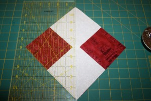 Use a ruler to cut the patch in half.
