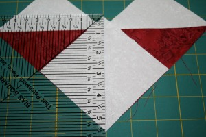 Using a ruler to cut the final stage of the flying geese units apart.