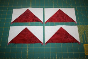 Four quick pieced Flying Geese Units.