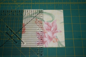 Marking center lines on back side of charm squares.