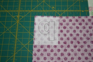Letter attached to the fabric.