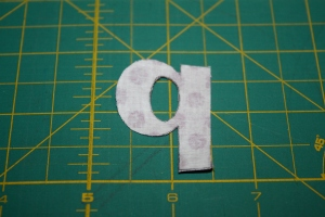 Back side of letter after cutting out.