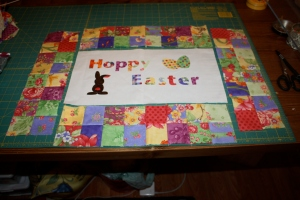 Borders laid out around mini quilt.