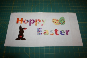 Applique pieces laid out on background fabric.
