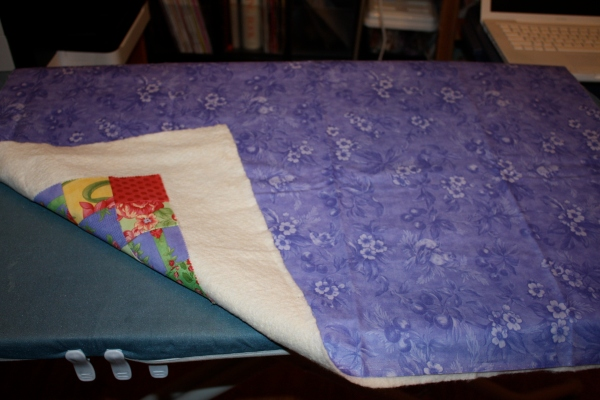 Step two of fusing the quilt sandwich.